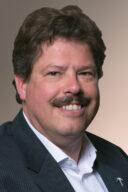 Portretafbeelding van Edwin Heithuis, hoofdredacteur van het Tijdschrift Familiebedrijven.